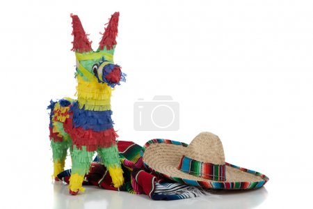 Photo for Mexican Serape, sombrero and pinata on a white background with copy space - Royalty Free Image