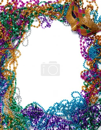 Photo for A border made of a gold, purple and green mardi gras mask and blue, green, red, gold and purple plastic beads - Royalty Free Image