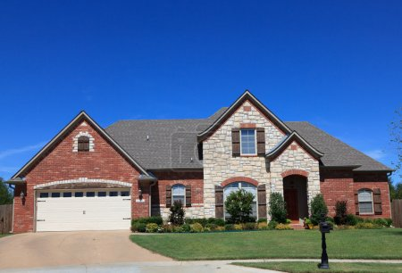 Photo for A beautiful brick home or house in front of a blue sky - Royalty Free Image