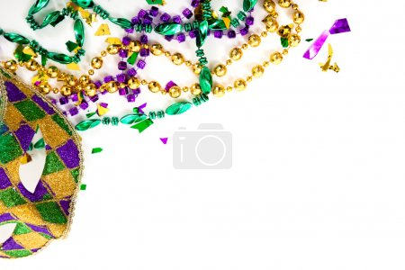 Photo for Purple, gold and green Mardi gras mask and beads on a white background with copy space - Royalty Free Image