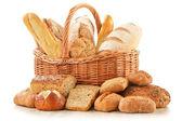 """Постер, картина, фотообои """"Хлеб и булочки в плетеную корзину, изолированные на белом фоне"""""""