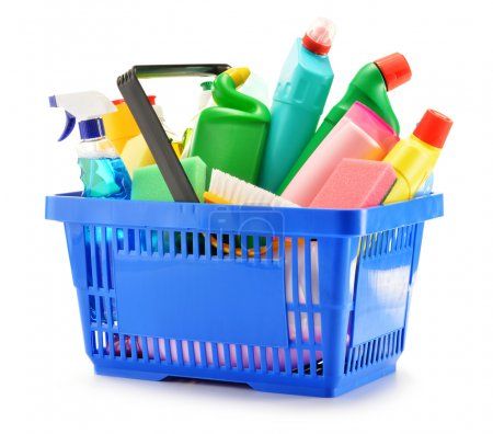 Photo for Shopping basket with detergent bottles and chemical cleaning supplies isolated on white - Royalty Free Image