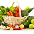 Composition with raw vegetables in wicker basket i...