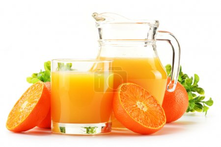 Composition with glass and jug of orange juice isolated on white