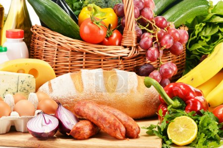 Assorted grocery products including vegetables fruits wine bread