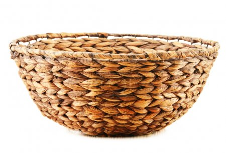 Empty wicker kitchen bowl isolated on white