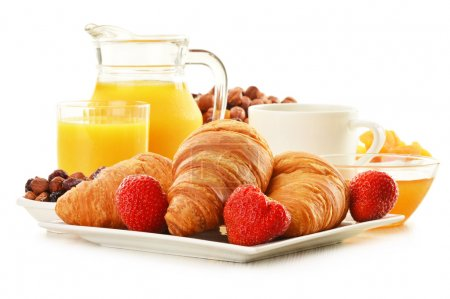 Breakfast with croissants, cup of coffee and fruit...