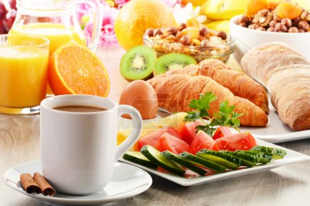 Photo for Breakfast with coffee, orange juice, croissant, egg, vegetables and fruits - Royalty Free Image