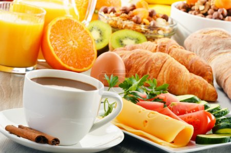 Breakfast with coffee, orange juice, croissant, eg...