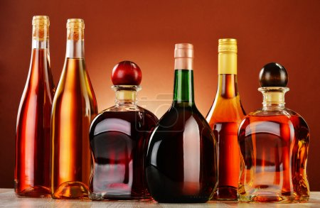 Photo for Bottles of assorted alcoholic beverages - Royalty Free Image