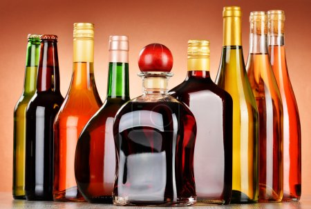 Photo for Bottles of assorted alcoholic beverages including beer and wine - Royalty Free Image