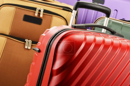 Composition with colorful travel suitcases
