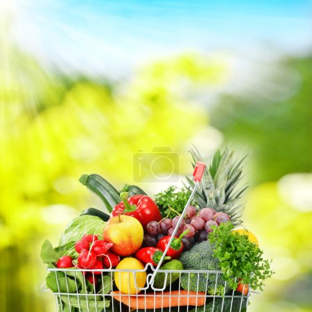 Photo for Wire shopping basket with groceries - Royalty Free Image