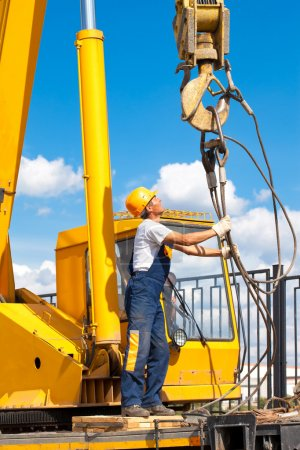 Construction worker during hoisting works