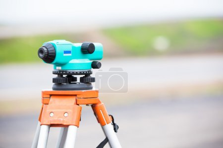 Surveying equipment theodolite during road works