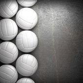 Volejbalový míč a kov zdi pozadí
