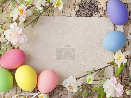 Photo for Easter eggs and blank note on wooden background - Royalty Free Image