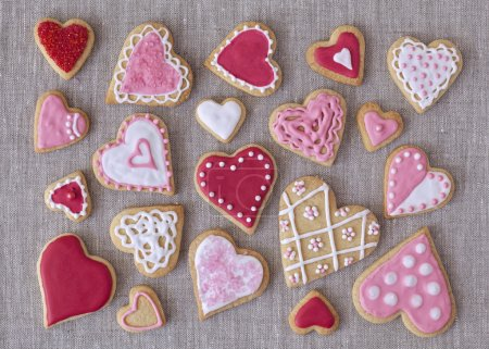 Photo for Red and pink heart cookies on a grey fabric background - Royalty Free Image