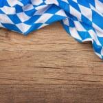 Oktoberfest blue checkered fabric on wooden backgr...