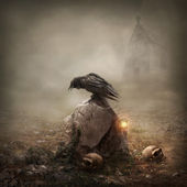 Crow sitting on a gravestone