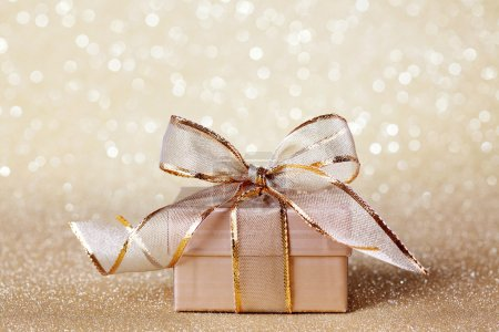 Photo for Christmas gift box on golden background - Royalty Free Image
