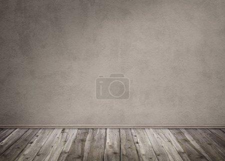 Photo pour Fond sombre avec un mur de pierre et plancher en bois - image libre de droit