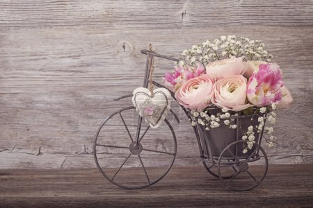 Photo for Ranunculus flowers in a bicycle vase - Royalty Free Image