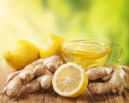Photo for Ginger tea with lemon on a wooden table - Royalty Free Image