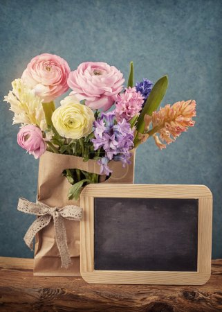 Flowers and a chalk board