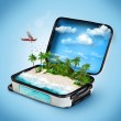 Open suitcase with a tropical island inside. Trave...