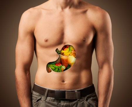 Photo for Beautiful male torso. Healthy food. - Royalty Free Image