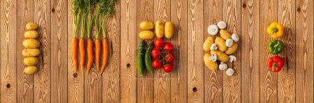 Photo pour Légumes sur fond de bois. Panorama - image libre de droit
