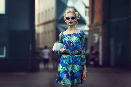 Photo for Beautiful stylish young woman on a street - Royalty Free Image