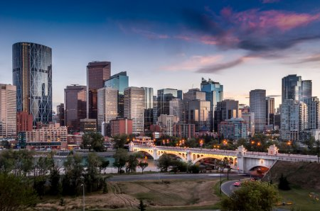 Photo for Calgary skyline at night with Bow River and Centre Street Bridge. - Royalty Free Image