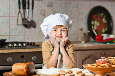 Photo for Cute girl baking cookies - Royalty Free Image