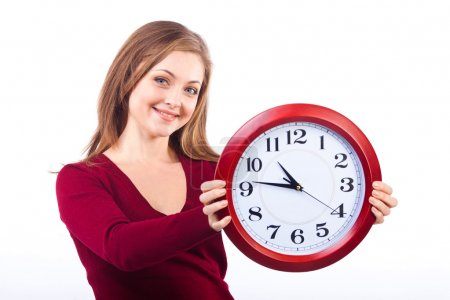 young smiling woman isolated on white background holding a clock