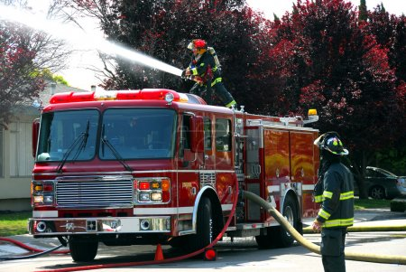 Firemen and fire truck at an apartment fire