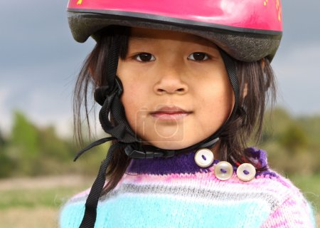 Girl in a pink helmet