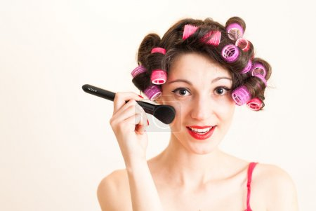 Woman putting makeup getting ready for fun