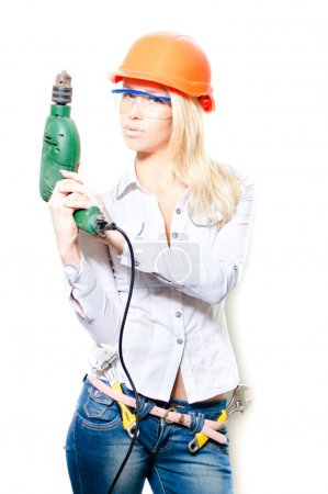 Woman in helmet with  drill