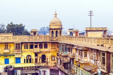 Photo for Typical houses with roof life in early morning light in old Delhi, India - Royalty Free Image