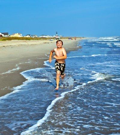 boys enjoying the beautiful ocean and beach