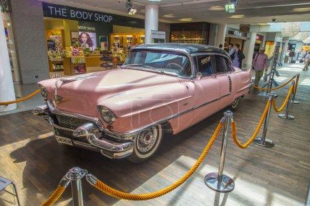 pink 1956 Cadillac at the