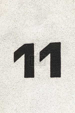 Photo pour Numéro de maison 11peint au mur - image libre de droit