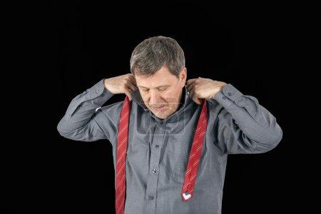 business man binds his tie