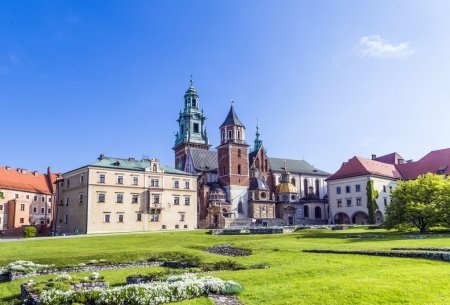 Wawel castle on sunny day with blue sky and white ...