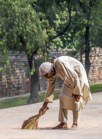 People work at Humayun's tomb