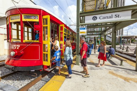 Passengers enter the famous red riverfront street car in New Orl