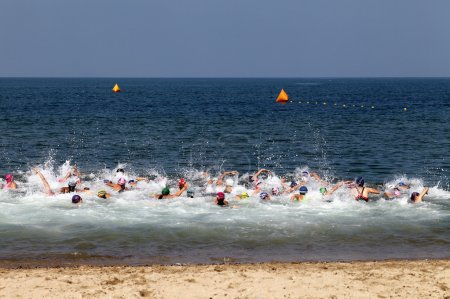 Photo for Triathlon athletes race - Royalty Free Image