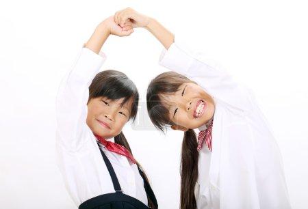 Two little asian schoolgirls